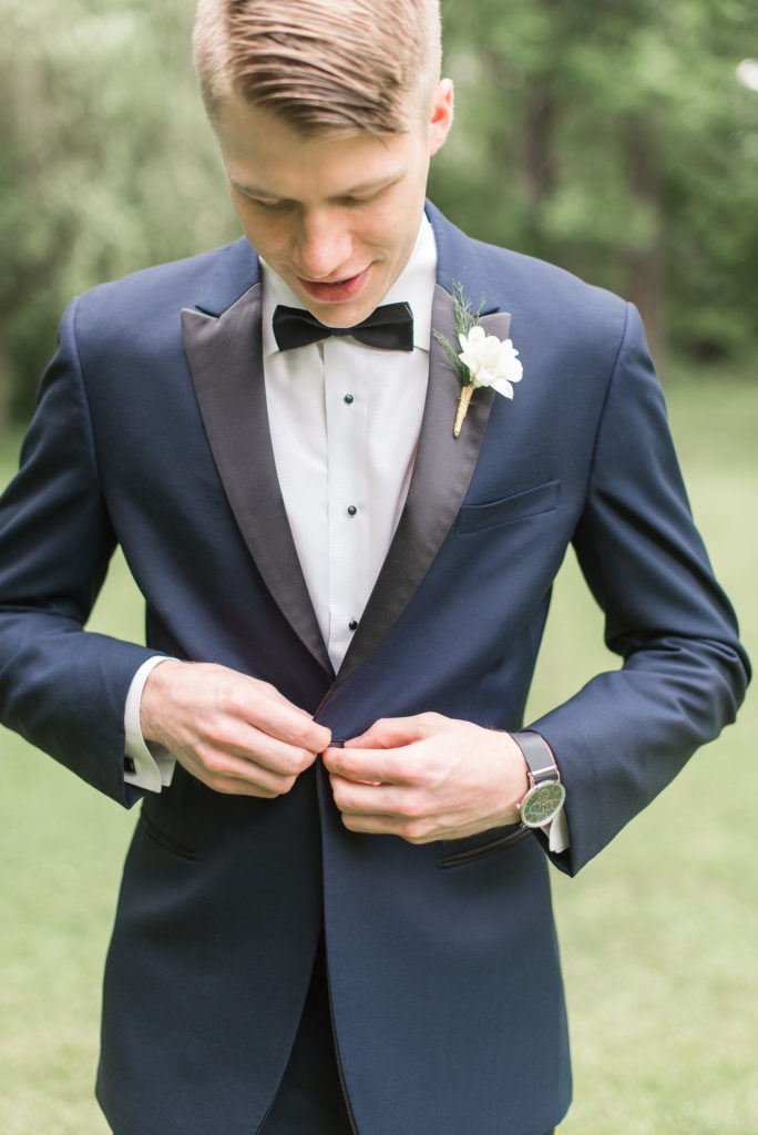Groom with with orchid Boutonniere